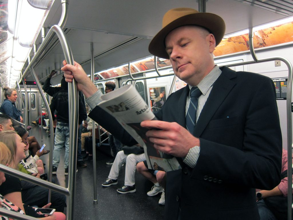 the author on the 6th strain coming into union Square reading a newspaper