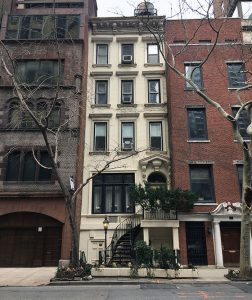 image of a brownstone painted white