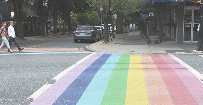 street in the west end painted with rainbow stripes