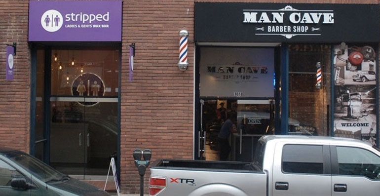 Various shops in Yaletown showing hair trimming and removal services.